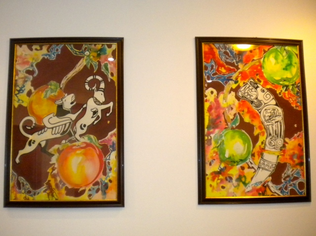Hotel paintings that wove apple motifs together with the Pazyryk tattoos