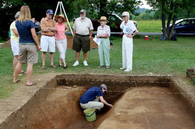 Dr. Alice Wright, talks to locals in  Haywood County NC, while I play in the dirt below - summer 2011.