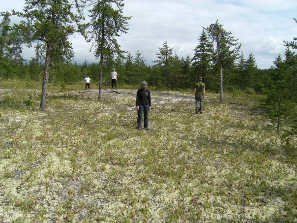 Showing elevation change by standing on a possible feature during a survey in Northern Quebec